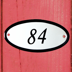 Huisnummerbordje ovaal nummer 83
